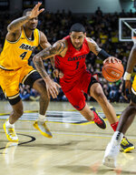Dayton forward Obi Toppin (1) drives around VCU forward Corey Douglas (4) during the first half of an NCAA college basketball game, Tuesday, Feb. 18, 2020, in Richmond, Va. (AP Photo/Zach Gibson)