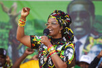 FILE - In this July, 29, 2017, file photo, Zimbabwean President Robert Mugabe's wife Grace greets party supporters at a rally in Chinhoyi, about 120 Kilometres west of the capital Harare. Known as a strong-willed woman with political ambitions, Grace Mugabe rose from being one of the president's secretaries to become first lady. (AP Photo/Tsvangirayi Mukwazhi, File)