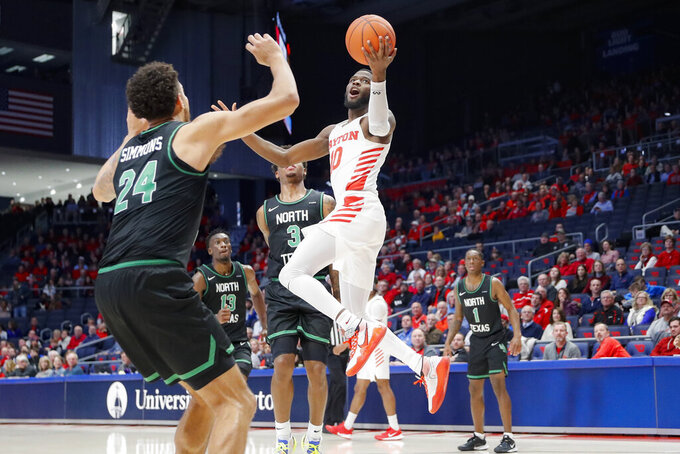 Dayton's Jalen Crutcher (10) shoots against North Texas' Zachary Simmons (24) during the second half of an NCAA college basketball game, Tuesday, Dec. 17, 2019, in Dayton, Ohio. (AP Photo/John Minchillo)