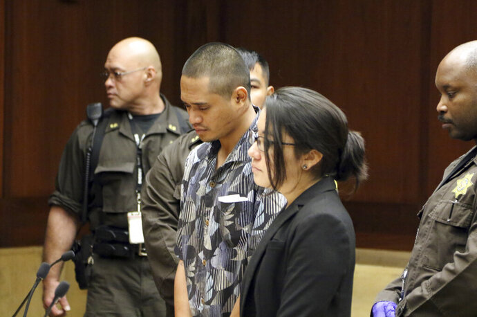 FILE - In this Jan. 31, 2019, file photo, Alins Sumang stands next to Deputy Public Defender Sarah Nishioka in court in Honolulu. Prosecutors say Sumang recklessly caused the deaths of Casimir Pokorny of Pennsylvania, Reino Ikeda of Japan and William Lau of Honolulu. Police say speed and alcohol appeared to factors in Monday's crash. (AP Photo/Jennifer Sinco Kelleher, File)