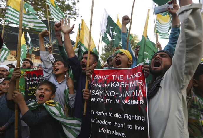 Pakistani students shout slogans against Indian government during a rally to express solidarity with Indian Kashmiris struggling for their independence, in Karachi, Pakistan, Friday, March 6, 2020. (AP Photo/Fareed Khan)
