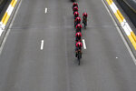Team Ineos strains during the second stage of the Tour de France cycling race, a team time trial over 27.6 kilometers (17 miles) with start and finish in Brussels, Belgium, Sunday, July 7, 2019. (AP Photo/Christophe Ena)