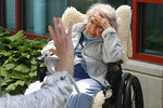 Eva Davis, 94, visits with her daughters outdoors at the Hebrew Rehabilitation Center, Wednesday June 10, 2020, in Boston, under the state's new nursing home visitation guidelines which requires social distancing. Davis hadn't been able to visit in person since March. (AP Photo/Elise Amendola)