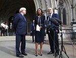 Anti Brexit campaigner Gina Miller speaks to the media outside the High Court in London, Friday, Sept. 6, 2019. The High Court  has rejected a claim that Prime Minister Boris Johnson is acting unlawfully in suspending Parliament for several weeks ahead of the country's scheduled departure from the European Union. (AP Photo/Alastair Grant)
