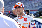 Driver Denny Hamlin, right, talks to Rick Hendrick before a NASCAR Cup Series auto race at Charlotte Motor Speedway in Concord, N.C., Sunday, May 30, 2021. (AP Photo/Nell Redmond)