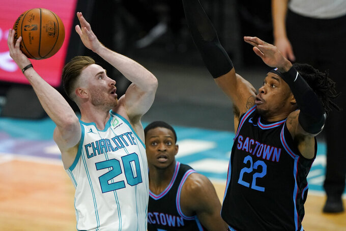 Charlotte Hornets forward Gordon Hayward shoots over Sacramento Kings center Richaun Holmes during the second half of an NBA basketball game on Monday, March 15, 2021, in Charlotte, N.C. (AP Photo/Chris Carlson)