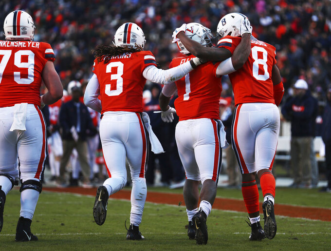 Virginia's tailback Jordan Ellis (1) celebrates a touchdown with his teammates in the first half of an NCAA college football game against Liberty  Saturday, Nov. 10, 2018, in Charlottesville, Va. (Zack Wajsgras /The Daily Progress via AP)