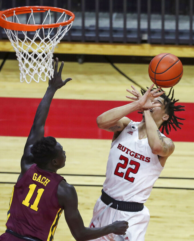Rutgers guard Caleb McConnell (22) loses the ball as Minnesota guard Both Gach (11) defends during the first half of an NCAA college basketball game Thursday, Feb. 4, 2021, in Piscataway, N.J. (Andrew Mills/NJ Advance Media via AP)