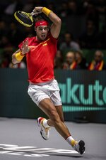 Spain's Rafael Nadal returns the ball to Argentina's Diego Schwartzman during a Davis Cup quarterfinal match in Madrid, Spain, Friday, Nov. 22, 2019. (AP Photo/Bernat Armangue)