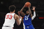 Seton Hall guard Myles Powell (13) attempts a basket as St. John's forward Ian Steere (33) defends during the first half of an NCAA college basketball game in New York, Saturday, Jan. 18, 2020. (AP Photo/Sarah Stier)