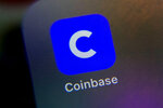 The mobile phone icon for the Coinbase app is shown in this photo, in New York, Tuesday, April 13, 2021. Coinbase is going public at a time when chatter about cryptocurrencies is everywhere, even at the United States Federal Reserve. (AP Photo/Richard Drew)