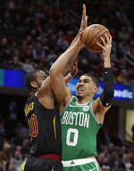 Boston Celtics' Jayson Tatum (0) shoots against Cleveland Cavaliers' Alec Burks (10) during the first half of an NBA basketball game Tuesday, Feb. 5, 2019, in Cleveland. (AP Photo/Tony Dejak)