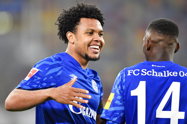 Schalke's Weston McKennie, left, celebrates with Schalke's Rabbi Matondo after scoring his side's opening goal during the German Bundesliga soccer match between Fortuna Duesseldorf and FC Schalke 04 in Duesseldorf, Germany, Wednesday, May 27, 2020. The nine-time defending Serie A champion McKennie has become the first American player at Juventus, confirmed late Saturday, August, 30, 2020.  (AP Photo/Martin Meissner, Pool, File)