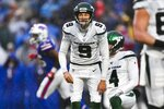 New York Jets kicker Sam Ficken (9) reacts after missing a field goal during the first half of an NFL football game against the Buffalo Bills Sunday, Dec. 29, 2019 in Orchard Park, N.Y. (AP Photo/Adrian Kraus)