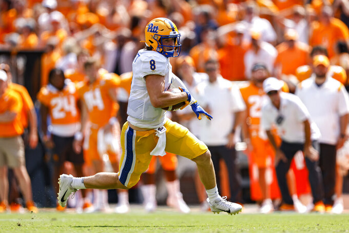 Pittsburgh quarterback Kenny Pickett (8) runs for yardage during the second half of an NCAA college football game against Tennessee, Saturday, Sept. 11, 2021, in Knoxville, Tenn. (AP Photo/Wade Payne)