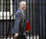 Britain's Brexit Secretary Stephen Barclay arrives at Downing Street for a Cabinet meeting, in London, Tuesday Feb. 19, 2019.  In an interview published Tuesday, EU Commission President Jean-Claude Juncker says he can't rule out that the United Kingdom would participate in upcoming European Parliament elections, while still trying to negotiate a delayed Brexit deal.(Stefan Rousseau/PA via AP)