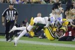 Detroit Lions' Tracy Walker III stops Green Bay Packers' Randall Cobb after a catch during the second half of an NFL football game Monday, Sept. 20, 2021, in Green Bay, Wis. (AP Photo/Mike Roemer)