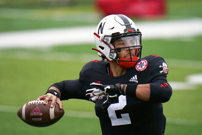 FILE - Nebraska quarterback Adrian Martinez (2) warms up before an NCAA college football game against Illinois in Lincoln, Neb., in this Saturday, Nov. 21, 2020, file photo. Adrian Martinez has been through a lot of losing, his body has taken a beating and he's dealt with the frustration of not being able to recapture the form that made him one of the nation's top freshman quarterbacks in 2018. He goes into his fourth season as Nebraska's starting quarterback planning to let it all hang out. (AP Photo/Nati Harnik, File)