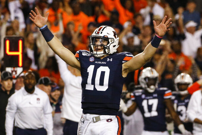 Auburn quarterback Bo Nix reacts after a penalty gave Auburn a first down and secured the win over Alabama during the second half of an NCAA college football game Saturday, Nov. 30, 2019, in Auburn, Ala. Auburn won 48-45. (AP Photo/Butch Dill)