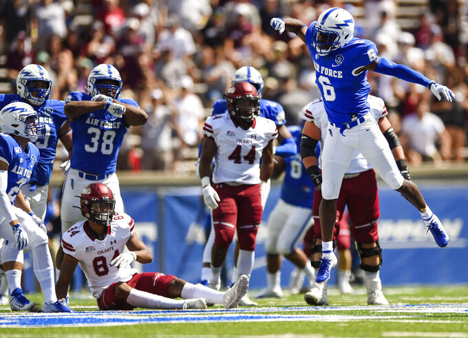 Air Force's Zane Lewis, front right, reacts after deflecting a pass during an NCAA college football game against Colgate at Air Force Academy, Colo., Saturday, Aug. 31, 2019. (Chancey Bush/The Gazette via AP)