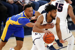 Robert Morris' Josh Williams, right, dribbles past Pittsburgh's Trey McGowens during the first half of an NCAA college basketball game in Pittsburgh, Tuesday, Nov. 12, 2019. (AP Photo/Gene J. Puskar)