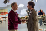 This image released by Sony Pictures shows Tom Hanks, left, and Matthew Rhys in a scene from