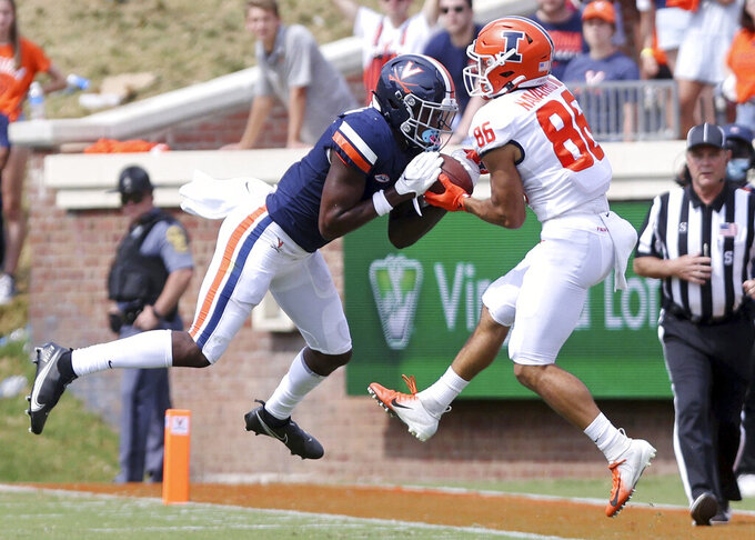 Virginia's Anthony Johnson (3) intercepts pass intended for Illinois wide receiver Donny Navarro III (86) during an NCAA college football game, Saturday, Sept. 11, 2021, at Scott Stadium in Charlottesville, Va. (Andrew Shurtleff/The Daily Progress via AP)