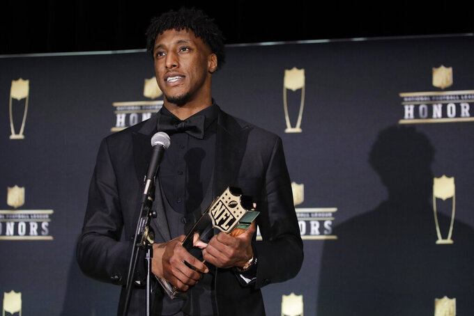 AP Offensive Player of the Year New Orleans Saints' Michael Thomas poses at the NFL Honors football award show Saturday, Feb. 1, 2020, in Miami. (AP Photo/Patrick Semansky)