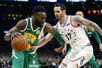 Boston Celtics' Jaylen Brown (7) is defended by Philadelphia 76ers' JJ Redick (17) during the first half of an NBA basketball game in Boston, Tuesday, Dec. 25, 2018. (AP Photo/Michael Dwyer)
