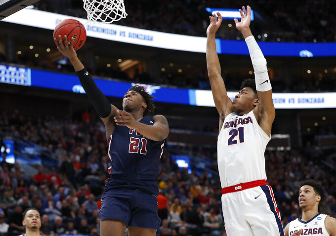 Fairleigh Dickinson forward Elyjah Williams drives to the basket against Gonzaga forward Rui Hachimura, right, during the second half of a first-round game in the NCAA men's college basketball tournament Thursday, March 21, 2019, in Salt Lake City. (AP Photo/Jeff Swinger)