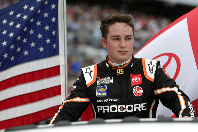 FILE - In this Feb. 16, 2020, file photo, Christopher Bell takes a parade lap in front of fans before the NASCAR Daytona 500 auto race at Daytona International Speedway in Daytona Beach, Fla. Bell understands the path to his new seat at Joe Gibbs Racing was bumpy in that it cost Erik Jones his job. But Bell's current team is closing at the end of the year and if Gibbs didn't pull him into the organization, he's not sure his Cup career would have continued. (AP Photo/John Raoux, File)