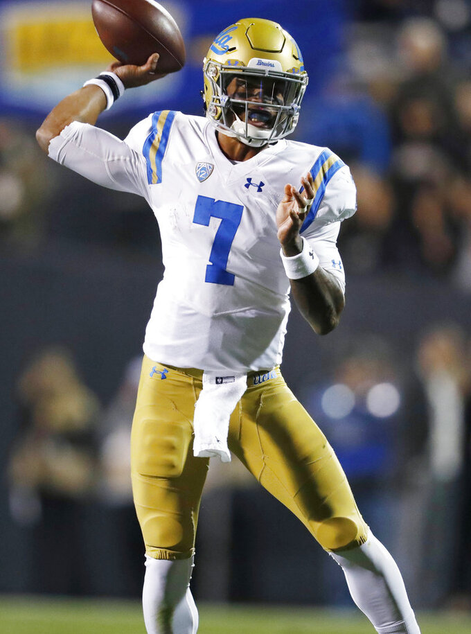 UCLA quarterback Dorian Thompson-Robinson throws a pass against Colorado during the first half of an NCAA college football game Friday, Sept. 28, 2018, in Boulder, Colo. (AP Photo/David Zalubowski)