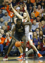 Florida State center Christ Koumadje (21) tries to get around Virginia forward Jay Huff (30) during the first half of an NCAA college basketball game in Charlottesville, Va., Saturday, Jan. 5, 2019. (AP Photo/Steve Helber)