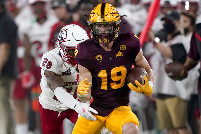 Arizona State wide receiver Ricky Pearsall (19) runs after a catch as Southern Utah safety Khalid Taylor (28) defends during the first half of an NCAA college football game, Thursday, Sept. 2, 2021, in Tempe, Ariz. (AP Photo/Matt York)