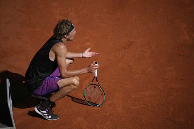 Germany's Alexander Zverev reacts as he plays Stefanos Tsitsipas of Greece during their semifinal match of the French Open tennis tournament at the Roland Garros stadium Friday, June 11, 2021 in Paris. (AP Photo/Christophe Ena)
