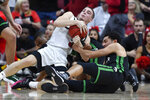 Louisville guard Ryan McMahon, left, battles South Carolina Upstate guard Josh Aldrich, right, for a loose ball during the first half of an NCAA college basketball game in Louisville, Ky., Wednesday, Nov. 20, 2019. (AP Photo/Timothy D. Easley)