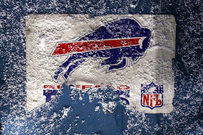Snow falls on a Buffalo Bills logo before an NFL divisional round football game against the Baltimore Ravens at Bills Stadium Saturday, Jan. 16, 2021, in Orchard Park, N.Y. (AP Photo/Jeffrey T. Barnes)