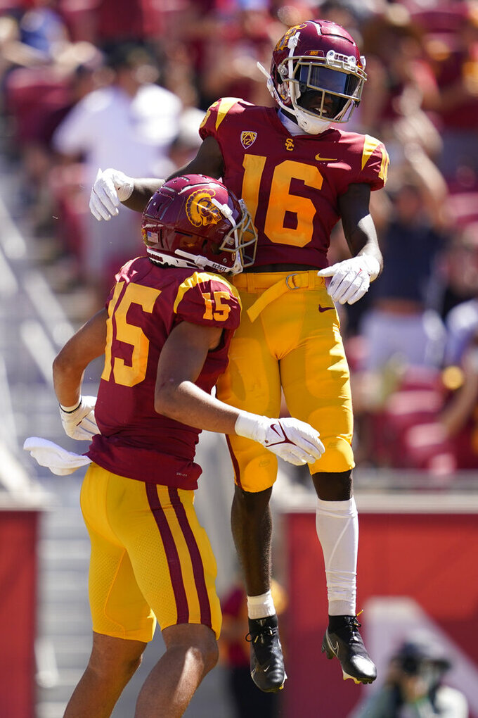 Southern California wide receiver Tahj Washington (16) celebrates with wide receiver Drake London (15) after catching a pass in the end zone for a touchdown during the first half of an NCAA college football game against San Jose State Saturday, Sept. 4, 2021, in Los Angeles. (AP Photo/Ashley Landis)
