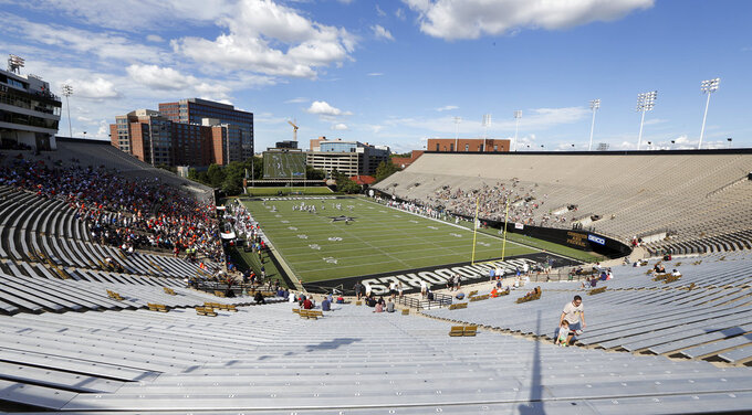 Fans watch an NCAA college football game between Virginia and Ohio being played in Vanderbilt Stadium Saturday, Sept. 15, 2018, in Nashville, Tenn. The game was moved to Nashville because of Hurricane Florence and fans were admitted for free. (AP Photo/Mark Humphrey)