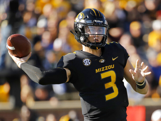 Missouri quarterback Drew Lock passes during the first half of an NCAA college football game against Kentucky, Saturday, Oct. 27, 2018, in Columbia, Mo. (AP Photo/Charlie Riedel)