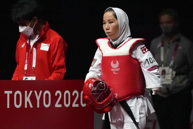 Afghanistan's Zakia Khudadadi enters the arena during her women's K44 49kg Taekwondo match against Ziyodakhon Isakova of Uzbekistan at Tokyo 2020 Paralympic Games, Thursday, Sept. 2, 2021, in Chiba, east of Tokyo, Japan. (AP Photo/Shuji Kajiyama)