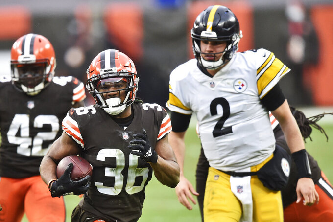 Cleveland Browns cornerback M.J. Stewart Jr. (36) returns an interception during the second half of an NFL football game against the Pittsburgh Steelers, Sunday, Jan. 3, 2021, in Cleveland. (AP Photo/David Richard)
