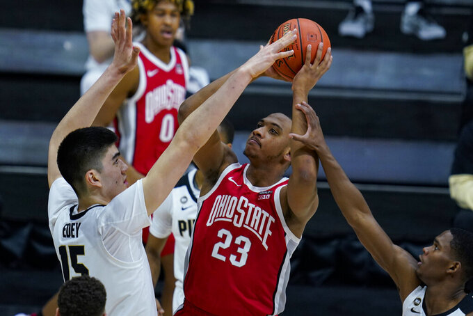 Ohio State forward Zed Key (23) shoots over Purdue center Zach Edey (15) in the first half of an NCAA college basketball game at the Big Ten Conference tournament in Indianapolis, Friday, March 12, 2021. (AP Photo/Michael Conroy)