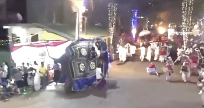 This frame from a Saturday, Sept.7, 2019 video provided by Derana Television, shows drummers running for cover as an elephant runs berserk during a Buddhist pageant in Kotte, near Colombo, Sri Lanka. At least 18 people were injured. (Derana Television via AP)
