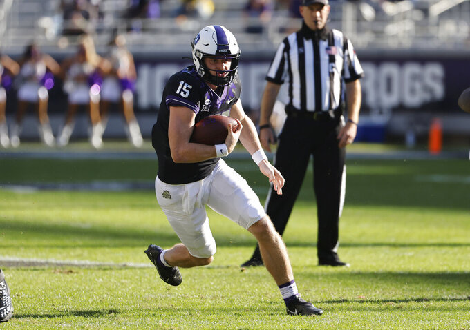 TCU quarterback Max Duggan (15) carries the ball against Texas Tech during the first half of an NCAA college football game Saturday, Nov. 7, 2020, in Fort Worth, Texas. (AP Photo/Ron Jenkins)