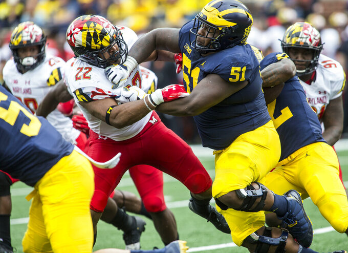 FILE - In this Oct. 6, 2018, file photo, Maryland inside linebacker Isaiah Davis (22) is blocked by Michigan offensive lineman Cesar Ruiz (51) in the second quarter of an NCAA college football game in Ann Arbor, Mich. Ruiz was selected by the New Orleans Saints in the first round of the NFL draft Thursday, April 23, 2020. (AP Photo/Tony Ding, File)