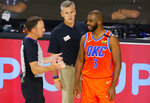 Oklahoma City Thunder's Chris Paul (3) talks with referee Josh Tiven, left, as coach Billy Donovan looks on during the third quarter of an NBA basketball game against the Phoenix Suns, Monday, Aug. 10, 2020, in Lake Buena Vista, Fla. (Mike Ehrmann/Pool Photo via AP)
