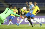 Brazil's Robson Bambu, center front, battles for the ball with Uruguay's Federico Vinas, second right, during a South America Olympic qualifying U23 soccer matchat the Hernan Ramirez Villegas stadium in Pereira, Colombia, Wednesday, Jan. 22, 2020. (AP Photo/Fernando Vergara)
