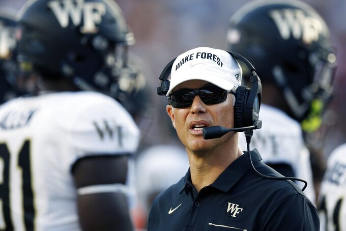 Wake Forest head coach Dave Clawson stands on the field during a timeout in the second half of an NCAA college football game against Boston College in Boston, Saturday, Sept. 28, 2019. (AP Photo/Michael Dwyer)