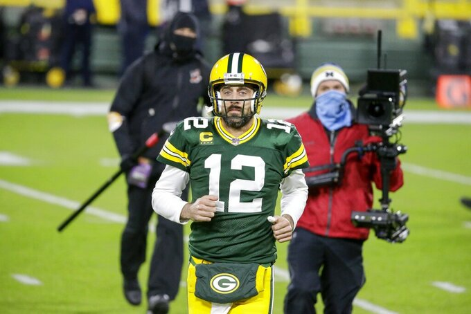 Green Bay Packers' Aaron Rodgers warms up before an NFL football game against the Chicago Bears -Sunday, Nov. 29, 2020, in Green Bay, Wis. (AP Photo/Mike Roemer)